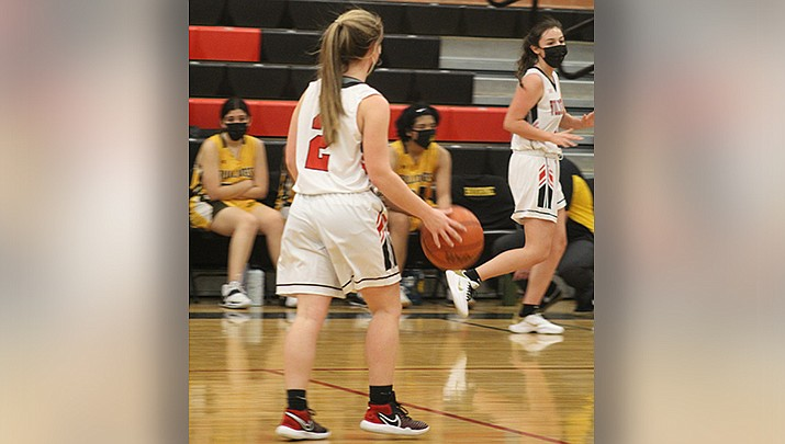 Point guard LaNae Burgess brings the ball up the court for Lee Williams, which lost by three points to visiting Coconino on Thursday, Feb. 4. (Photo by Casey Jones/Kingman Miner)