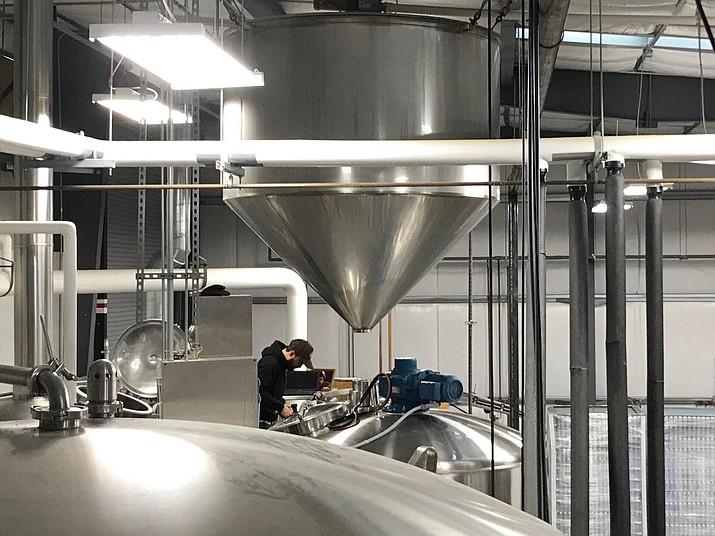 """At Wren House Brewing's recently opened Prescott production complex, 6396 Lear Lane east of Prescott Regional Airport, Wren House first brewed a """"tank full"""" of its popular hoppy, pale ale called Spellbinder. (Wren House Brewing/Courtesy)"""