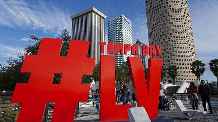 Blue skies and favorable weather greets the thousands of fans attending the festivities at Curtis Hixon Park during the NFL's Super Bowl 55 Experience on Saturday, Jan. 30, 2021 in Tampa. The CDC is suggesting that adults who are at increased risk for getting a severe case of COVID-19 think hard about attending an in-person watch party this year. (Luis Santana/Tampa Bay Times via AP)