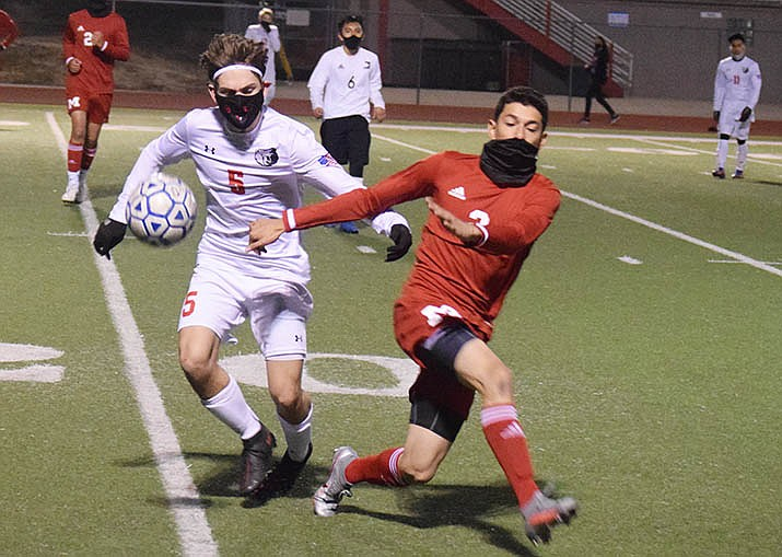 Mingus senior Fernando Ochoa, right, clears the ball away from a Bradshaw Mountain player in a recent match. The Marauders notched an impressive 3-0 shutout with late goals Wednesday at Coconino and are set to host Flagstaff on Saturday, Feb. 13. VVN/Jason W. Brooks