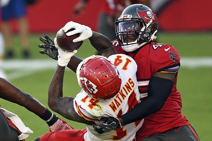 Tampa Bay Buccaneers inside linebacker Devin White (45) takes down Kansas City Chiefs wide receiver Sammy Watkins (14) after a reception during the first half of an NFL football game Sunday, Nov. 29, 2020, in Tampa, Fla. Watkins took a pay cut to remain with the Chiefs in 2020, but at $9 million, he was far from a bargain and that all plays toward the salary cap. (Jason Behnken/AP)