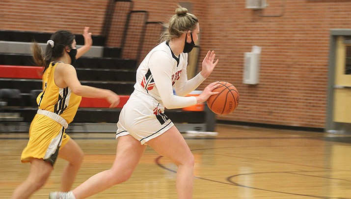 Becca Arave, right, scored a game-high 14 points for Lee Williams High School in the Lady Volunteers' double-overtime win at Bradshaw Mountain on Friday, Feb. 5. (Miner file photo)