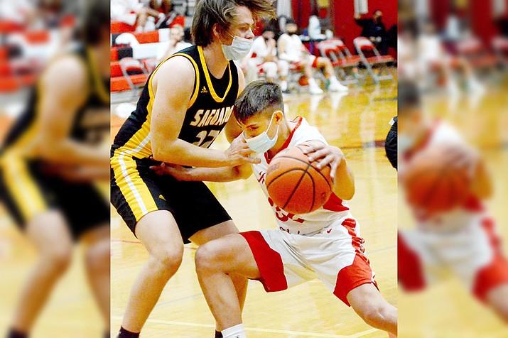Mingus Union's Dante Gabandon (No. 32) scored nine points against Coconino on Feb. 5. Thursday, the 1-5 travel to Prescott Valley to face Bradshaw Mountain High School. VVN/Vyto Starinskas