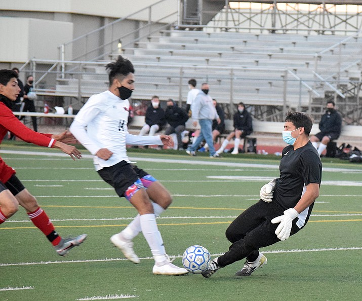 Mingus senior goalkeeper Jesus Velazco, right, knocks the ball away from a Lee Williams player in Friday's 1-0 Mingus win. The Marauders play a non-region road match Thursday before hosting Flagstaff High School at 1 p.m. Saturday. VVN/Jason W. Brooks