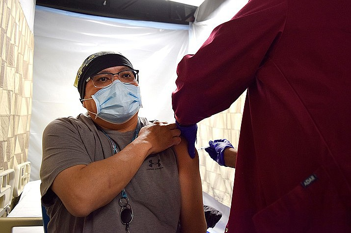 Preston Masayumptewa, a registered nurse, receives the COVID-19 vaccine at Tuba City Regional Health Care Corp in Tuba City, Arizona. (Photo/Tuba City Regional)