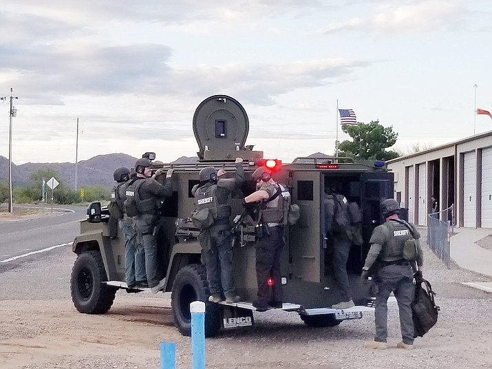 """A Yavapai County Sheriff's Office SWAT team gets ready to head to a scene where a 57-year-old Chino Valley man threatened to take his own life via """"suicide by cop."""" (CVPD/Courtesy)"""
