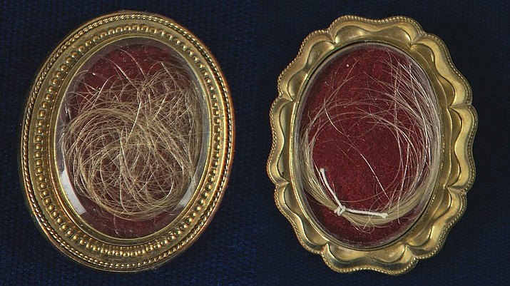 This undated photo released by RR Auction shows locks of hair from the heads of the first United States President George Washington, right, and from his wife Martha, left, up for auction between between Feb. 11-18, 2021, by the Boston-based auction firm. (Nikki Brickett/RR Auction via AP)