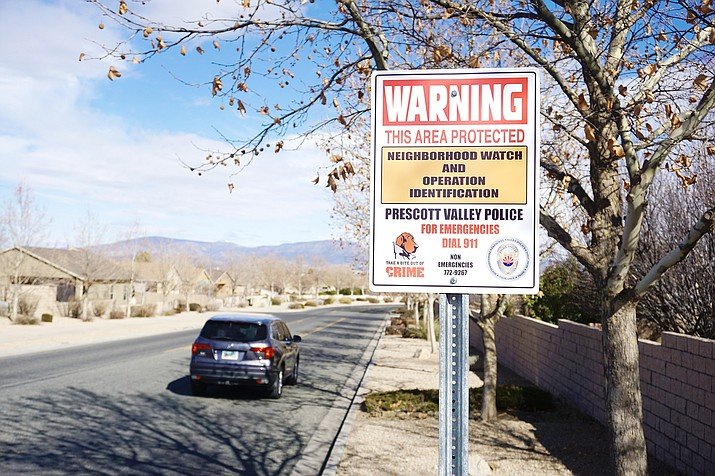 A neighborhood watch sign is posted in Prescott Valley warning potential criminals that they are being watched by those who live there. (Aaron Valdez/Courier)