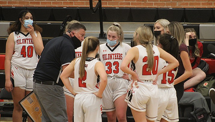 Lee Williams High School girls basketball coach Jerry Arave instructs his players during a timeout during the Lady Volunteers 62-44 win over Mingus Union on Tuesday, Feb. 9. (Photo by Casey Jones/Kingman Miner)