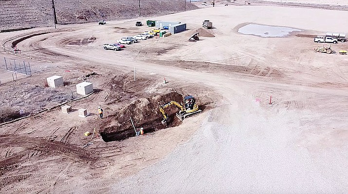 Viewed from a drone, crews begin to dig the trenches for underground utilities at the site for the new Prescott Justice Center and Jail along Prescott Lakes Parkway on Feb. 9, 2021. The county announced this past week that the first phase of mass grading is largely complete. (Yavapai County/Courtesy)