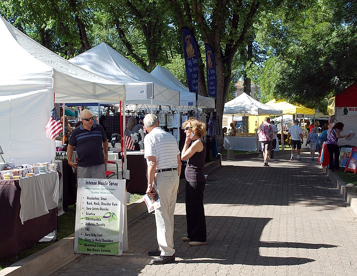 Visitors to the Territorial Days Arts & Crafts Show in downtown Prescott on June 13, 2020, look at a vendor's wares. The 2021 Territorial Days/Arts & Crafts Show is scheduled for Saturday, June 12, and Sunday, June 13. (Tim Wiederaenders/Courier, file)
