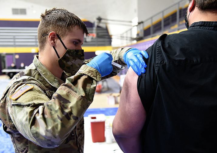 An Arizona National Guard soldier administers COVID-19 vaccine in Payson in this Jan. 4 file photo. The state this week passed the 1 million mark in vaccine doses administered, including second doses for more than 200,000 people. (Photo by Tech. Sgt. Michael Matkin, Arizona National Guard/Creative Commons)