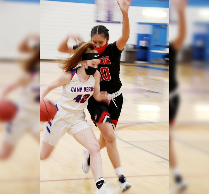 Camp Verde sophomore Shelly Warfield drives to the basket on Feb. 9 against Page. Photo courtesy Erica Graves