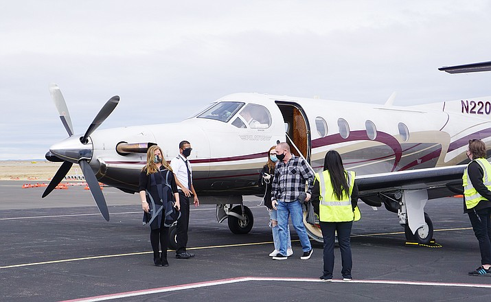Passengers arrive at the Prescott Regional Airport on Boutique Air's inaugural flight between Phoenix and Prescott. The city conducted a ribbon-cutting for the new flights at the Prescott Regional Airport on Monday, Feb. 15, 2021. (Cindy Barks/Courier)