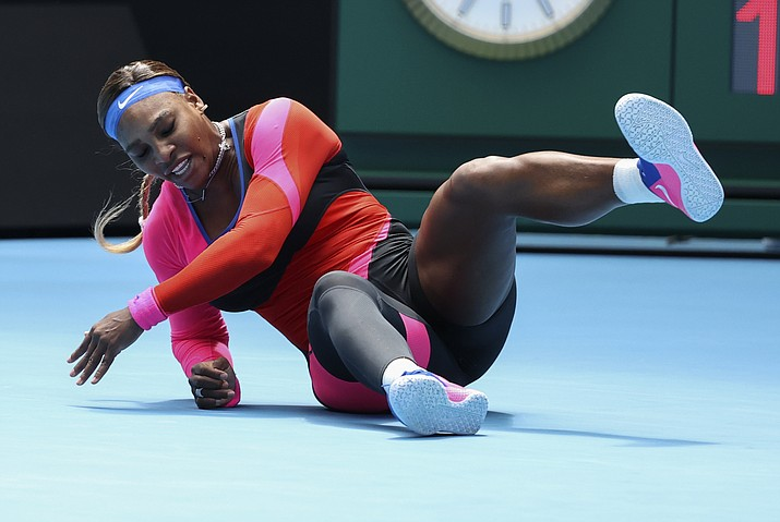 United States' Serena Williams falls during her fourth round match against Aryna Sabalenka of Belarus at the Australian Open tennis championship in Melbourne, Australia, Sunday, Feb. 14, 2021. (Hamish Blair/AP)