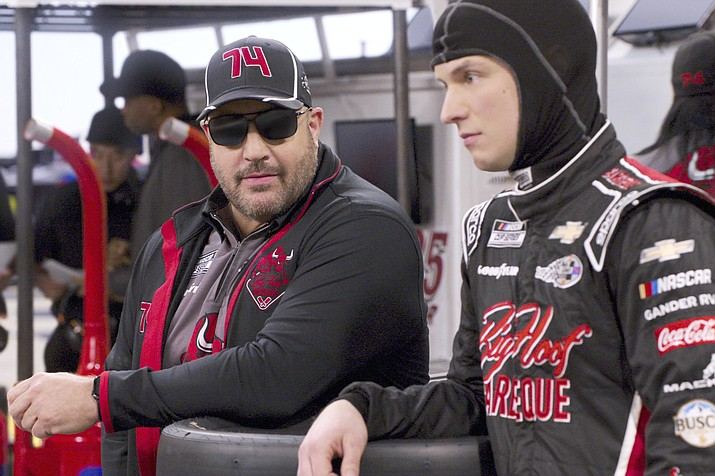 "Kevin James, left, and Freddie Stroma in a scene from the comedy series ""The Crew."" (Netflix via AP)"