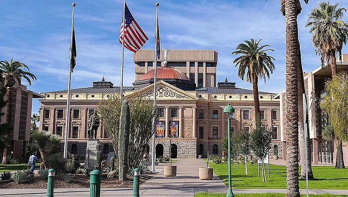 Arizona lawmakers are considering boosting penalties for people arrested at protests, drawing fierce opposition from civil rights groups worried officers will target Black Lives Matter demonstrators or others with messages police find distasteful. The state Capitol in Phoenix is shown. (Photo by Visitor7, cc-by-sa-3.0, https://bit.ly/3o0fG5x)