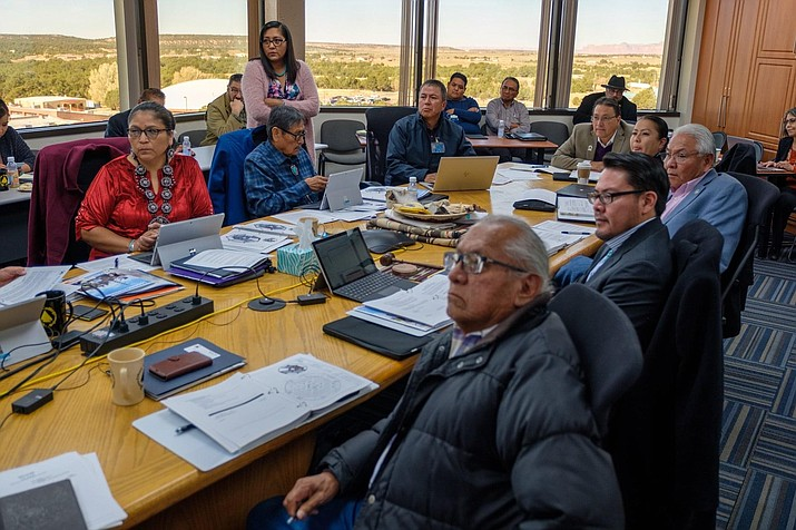 Diné College Board of Regents seated at the table in Tsaile, Arizona. at a regular board meeting before the pandemic. Diné  College was  recently recognized for its leadership and initiatives. (Photo/Diné College)