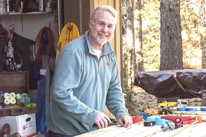Grand Canyon Village resident Scott Rommel recently started his company, Soledaddy Longboards, where he makes custom longboards. The boards can be viewed and purchased on his website or at Aspen Sports in Flagstaff, Arizona. (V. Ronnie Tierney/WGCN)