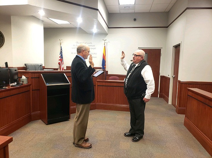 Williams Justice Court Judge Rob Krombeen (left) administers the oath of office to Greg King, who will serve as constable of the Williams precinct. (Photo/Williams Justice Court)