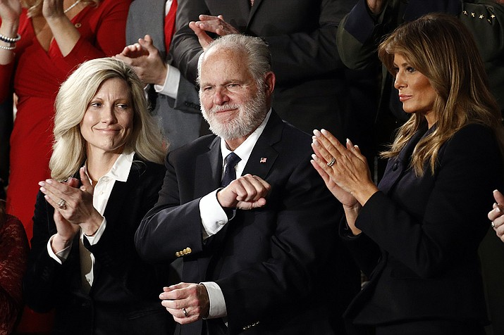 In this Feb. 4, 2020 file photo, Rush Limbaugh reacts as first Lady Melania Trump, and his wife Kathryn, applaud, as President Donald Trump delivers his State of the Union address to a joint session of Congress on Capitol Hill in Washington. Limbaugh, the talk radio host who became the voice of American conservatism, has died. (AP Photo/Patrick Semansky, File)