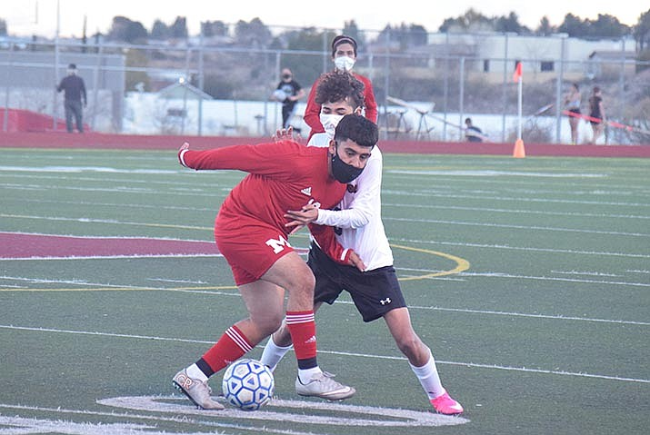 Mingus Union junior Hgiovani Lagunas, foreground, battles for the ball in a recent match. The Marauders, who lost two matches last week, are set to host Moon Valley, a Phoenix team, Friday, Feb. 19, 5 p.m. at MUHS. VVN/Jason W. Brooks photo