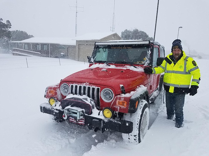 Don Baier stands by a red Jeep Wrangler as part of the Yavapai County Jeep Posse. Baier is a retired airline pilot, having flown Air Force 2 while serving. The Posse assisted in over 200 missions during the two January 2021 snowstorms when the Prescott area received more than 20 inches of snow. (Yavapai County Jeep Posse/Courtesy)