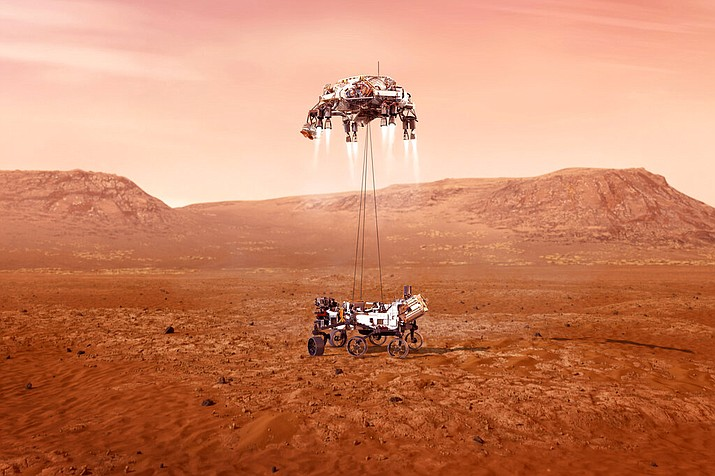 """This illustration provided by NASA shows the Perseverance rover, bottom, landing on Mars. Hundreds of critical events must execute perfectly and exactly on time for the rover to land safely on Feb. 18, 2021. Entry, Descent, and Landing, or """"EDL,"""" begins when the spacecraft reaches the top of the Martian atmosphere, traveling nearly 12,500 mph (20,000 kph). EDL ends about seven minutes after atmospheric entry, with Perseverance stationary on the Martian surface. (NASA/JPL-Caltech via AP)"""