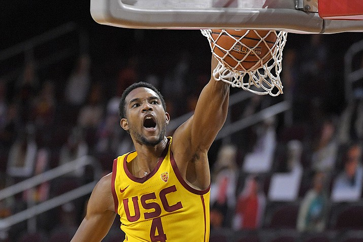 Southern California forward Evan Mobley dunks during the second half of the team's NCAA college basketball game against Arizona State on Wednesday, Feb. 17, 2021, in Los Angeles. USC won 89-71. (Mark J. Terrill/AP)