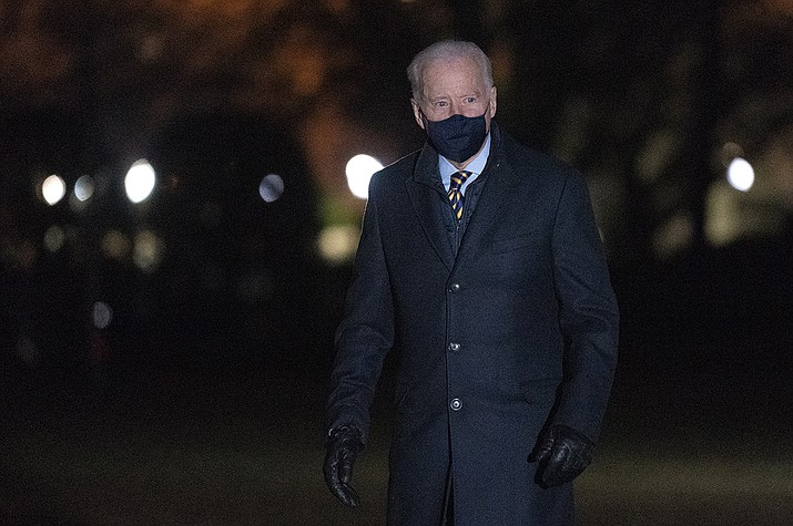 President Joe Biden walks on the South Lawn of the White House after stepping off Marine One, Wednesday, Feb. 17, 2021, in Washington. Biden was returning to Washington after participating in a town hall event in Wisconsin. (Patrick Semansky/AP)