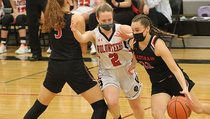 Lee Williams senior LaNae Burgess (2) fights her way through a pick during the Lady Volunteers' 36-24 win over Bradshaw Mountain on Tuesday, Feb. 16. (Photo by Travis Rains/Kingman Miner)