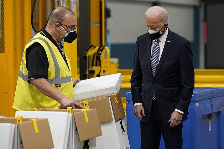 President Joe Biden tours a Pfizer manufacturing site, Friday, Feb. 19, 2021, in Portage, Mich. (Evan Vucci/AP)