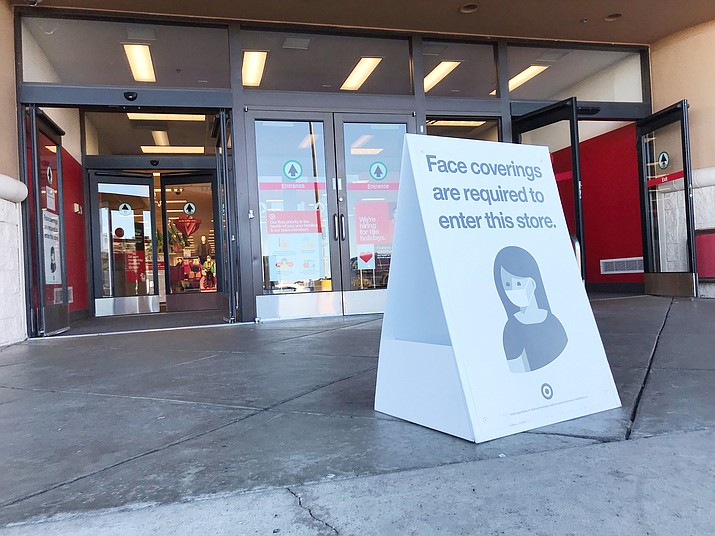 In this file photo a sign outside of the Prescott Target store reminds customers that face masks are required. Fewer than 65,000 new coronavirus cases were reported in the U.S. Monday, Feb. 15, 2021, indicating a slowing of COVID-19 spread. Former CDC Director Tom Frieden recently endorsed the idea that Americans are now seeing the effect of their good behavior — not of increased vaccinations. (Richard Haddad/Courier, file)