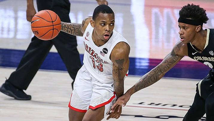 Arizona junior guard James Akinjo scored 21 points, but the Wildcats lost to UCLA on Thursday, Feb. 18 in an NCAA men's basketball game. (Photo by Mike Mattina/Arizona Athletics)
