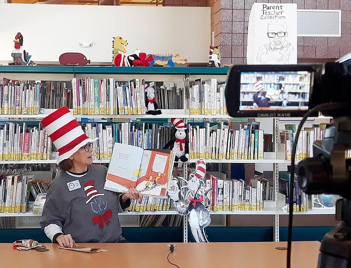 """Joyce Read, youth services coordinator at the Cottonwood Public Library reads """"What Pet Should I Get?"""" by Dr. Seuss on Thursday, Feb. 18. Photo courtesy of the Cottonwood Public Library"""