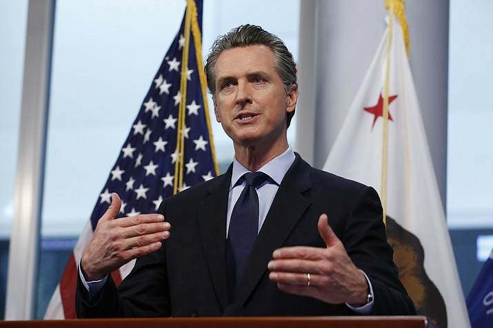 In this April 9, 2020 photo California Gov. Gavin Newsom gives his coronavirus update at the Governor's Office of Emergency Services in Rancho Cordova, Calif. Like Andrew Cuomo of New York, Newsom is finding the crisis that elevated his stock, can dim it too. He is facing a potential recall election. (Rich Pedroncelli/AP, File)