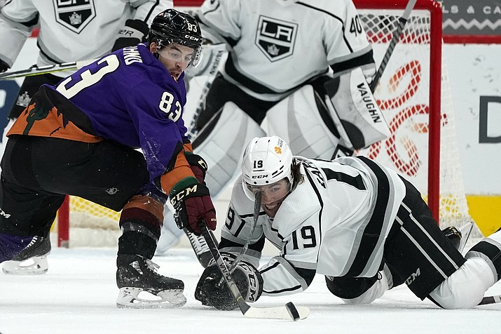 Arizona Coyotes right wing Conor Garland (83) battles with Los Angeles Kings right wing Alex Iafallo (19) for the puck during the second period of an NHL hockey game Saturday, Feb. 20, 2021, in Glendale, Ariz. (Ross D. Franklin/AP)