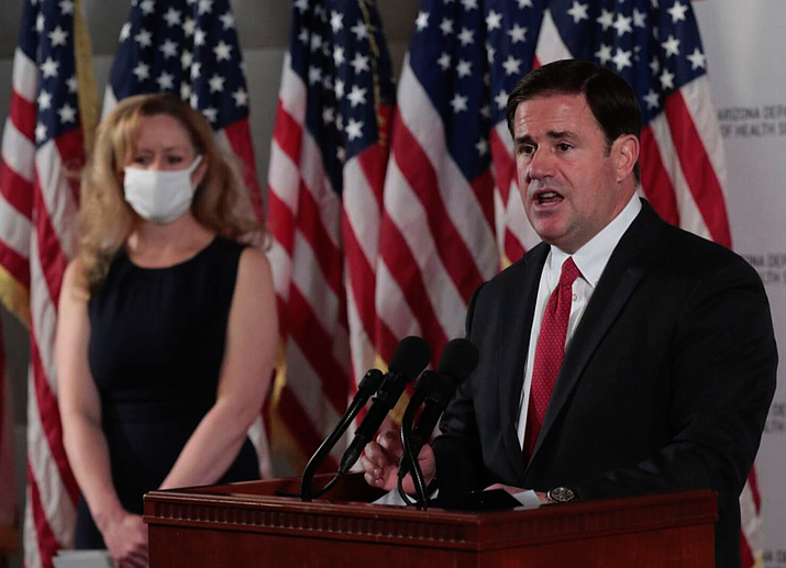 Would Gov. Doug Ducey, shown here with state Health Director Dr. Cara Christ behind him, sign a law that goes against his own directive allowing municipalities to impose COVID-19 mask requirements? A House committee has passed a Republican sponsored bill that would allow Arizona business owners to decide whether to enforce mask mandates for employees and customers, a move supporters say promotes freedom and critics call a threat to health and safety. File photo