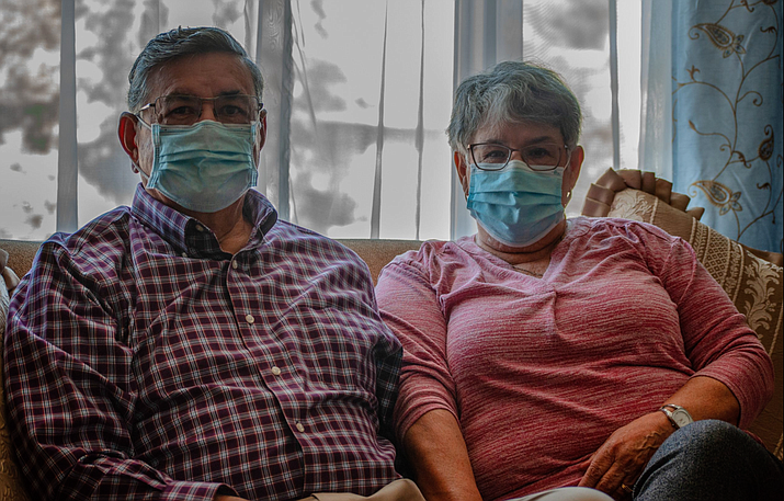 Saul and Lupe Solis, in their Chandler home on Feb. 17, are two of the thousands of Arizonans who have received both doses of the COVID-19 vaccine. (Photo by Kiersten Moss/Cronkite News)