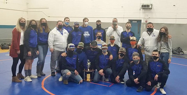Chino Valley wrestling takes a team photo after defeating Prescott in a dual meet 45-24 on Wednesday, Feb. 17, 2021, in Chino Valley. The Cougars will get to keep the Legler Cup for a third straight year since they defeated both Prescott and Bradshaw Mountain this season. (Chino Valley Wrestling/Courtesy)