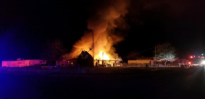 Copper Canyon Fire Marshal Ken Krebbs said this home, located near West Pike Drive and Middle Verde Road, is likely a total loss after a fire broke out in the carport area and spread, Saturday morning. Courtesy of Copper Canyon Fire