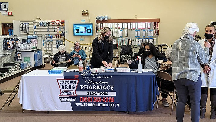 The coronavirus death toll in the United States is expected to surpass 500,000 this week, even as the nation ramps up its vaccination program. Area residents are shown receiving COVID-19 vaccinations at Uptown Drug in Kingman in this file photo. (File photo courtesy of Uptown Drug)