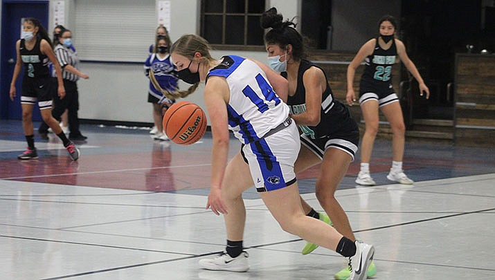 The Kingman Academy High School girls basketball team beat Chino Valley 42-34 on Saturday, Feb. 20. Academy's Amme Benson (14) is shown chasing a loose ball in this file photo. (Photo by Casey Jones/Kingman Miner)
