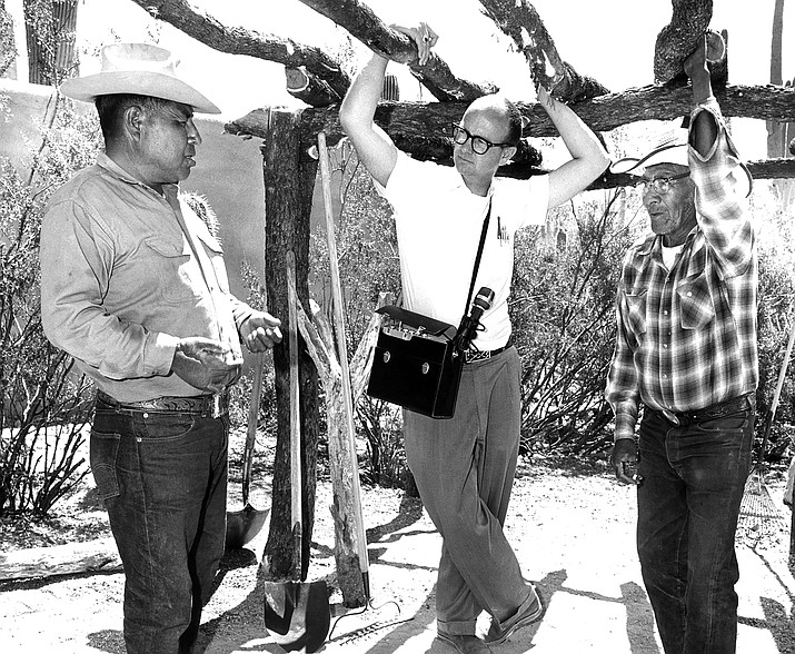 Lorentino Noceo, Bernard Fontana and Frank Lopez discussing the reconstruction of a brush house and ramada at the Arizona Sonora Desert Museum as part of the original Doris Duke Native American Oral History Project. (Photo/Helga Teiwes, 1968. ASM 18920, courtesy of Arizona State Museum at the University of Arizona)