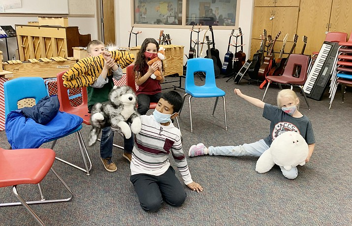 From left, Cottonwood Community School students Samara Drought-Clark, Sophia Butler, Pedro Gomez Bautista and Mason Garver put on a musical puppet show for other students. Photo courtesy Cottonwood-Oak Creek School District