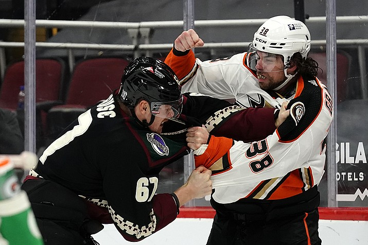 Arizona Coyotes left wing Lawson Crouse (67) and Anaheim Ducks center Derek Grant (38) fight in the first period during an NHL hockey game, Monday, Feb. 22, 2021, in Glendale, Ariz. (Rick Scuteri/AP)