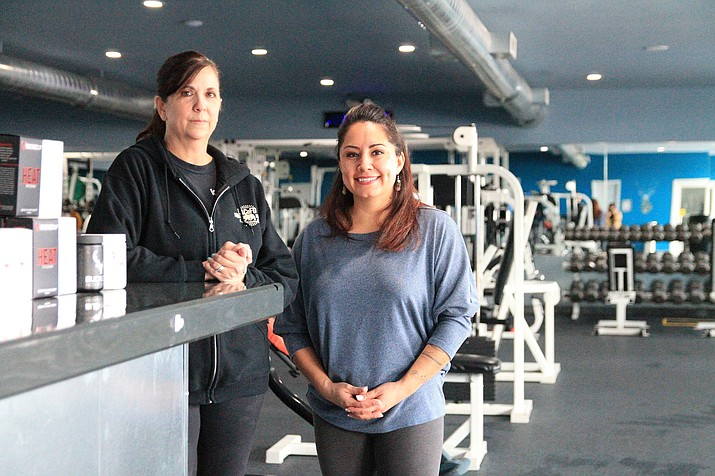 Results Fitness Center has relocated to a new 5,000 square foot facility in Williams. The newly renovated gym offers 24-hour acces. From left: Results Fitness employee Janna Gimenez and General Manager Julia Pearson greet members. (Loretta McKenney/WGCN)