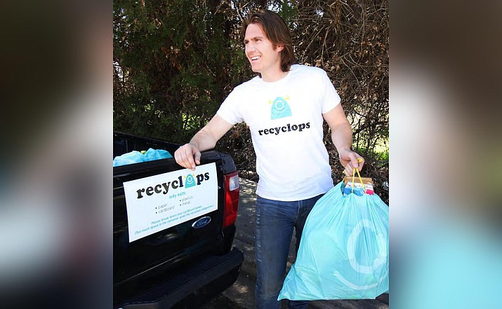 D. Gavin Smith picks up recycling from one of Recyclops' customers. The curbside pickup recycling company has launched a sign-up campaign to provide service to Camp Verde and Cottonwood. Courtesy photo