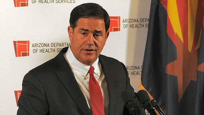 Cutline: Arizona Gov. Doug Ducey on Tuesday ordered the lowering of flags in the state for five days to honor victims of the coronavirus pandemic. (File photo by Howard Fischer/For the Miner)