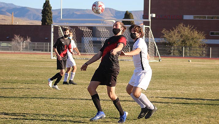 Lee Williams' Beauen Bratley controls a pass during his team's 2-0 win over Estrella Foothills in a high school boys soccer game on Tuesday, Feb. 23. (Photo by Casey Jones/Kingman Miner)